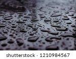 water drop or rain drop on the... | Shutterstock . vector #1210984567