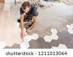 male worker installing new... | Shutterstock . vector #1211013064