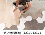 male worker installing new...   Shutterstock . vector #1211013121