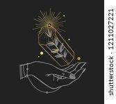 women's hand holding a magic...   Shutterstock .eps vector #1211027221