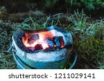 Small photo of Wood firebrand in the oven On the grass.