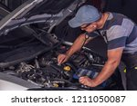 car service worker diagnoses... | Shutterstock . vector #1211050087