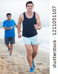 two friends are jogging in time ... | Shutterstock . vector #1211051107