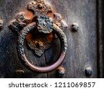 an old  rusty door handle | Shutterstock . vector #1211069857