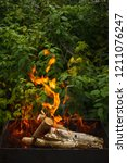 fire and firewood in a burning... | Shutterstock . vector #1211076247