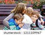 mother and three children... | Shutterstock . vector #1211109967