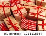 christmas gift box on tablet   Shutterstock . vector #1211118964