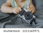 baby and digital cameras. the...   Shutterstock . vector #1211165971