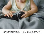 asia baby and digital cameras.    Shutterstock . vector #1211165974