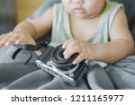 baby and digital cameras. the...   Shutterstock . vector #1211165977