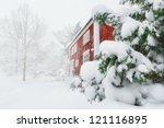 Red House In Snowfall With...