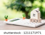 a model house model is placed...   Shutterstock . vector #1211171971