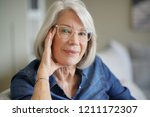 attractive senior woman at... | Shutterstock . vector #1211172307