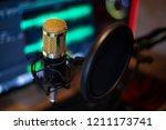 golden microphone at audio... | Shutterstock . vector #1211173741