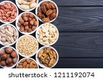 mix of nuts   pistachios ... | Shutterstock . vector #1211192074