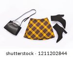 stripy pants with black boots... | Shutterstock . vector #1211202844
