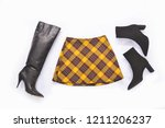 stripy pants with black boots... | Shutterstock . vector #1211206237