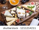cheeseboard with cheese brie  ... | Shutterstock . vector #1211214211