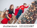 dad helping son to decorate...   Shutterstock . vector #1211221087
