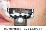 a man shaves the machine...   Shutterstock . vector #1211239384