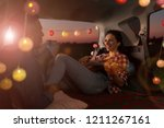 young couple sitting in their... | Shutterstock . vector #1211267161
