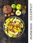 vegan apple salad in a bowl....   Shutterstock . vector #1211329117