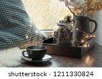 still life in home interior.... | Shutterstock . vector #1211330824