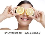 young woman holding lemon slice ... | Shutterstock . vector #121138669