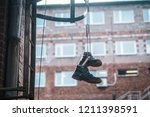 Boots Hanging On The Laces At...