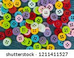 colored clothing buttons for... | Shutterstock . vector #1211411527