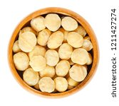 roasted and salted macadamia... | Shutterstock . vector #1211427274