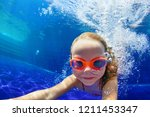 happy family in swimming pool.... | Shutterstock . vector #1211453347