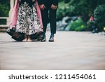 pakistani indian couple showing ... | Shutterstock . vector #1211454061