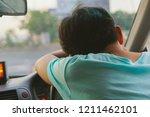 close up of a man sleeping... | Shutterstock . vector #1211462101