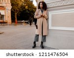 outdoor fashion portrait of...   Shutterstock . vector #1211476504