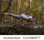 Girl Doing Yoga Exercise On Th...