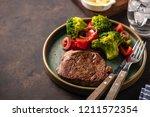 grilled beef steak with... | Shutterstock . vector #1211572354