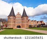 historical holstentor city gate ... | Shutterstock . vector #1211605651