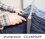 wear hanging on rack. male... | Shutterstock . vector #1211605654