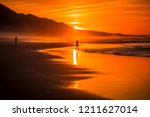 tropical beach sunset at the... | Shutterstock . vector #1211627014
