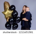 holiday photo of mom and baby... | Shutterstock . vector #1211651581
