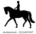 A Silhouette Of A Rider On A...