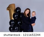 holiday photo of a cute mom and ... | Shutterstock . vector #1211652244