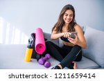 female athlete using a mobile... | Shutterstock . vector #1211659414