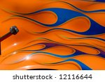 blue flames painted on orange...