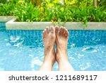 old woman feet  in soft focus ... | Shutterstock . vector #1211689117