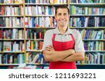 a worker at a bookstore smiling ...   Shutterstock . vector #1211693221