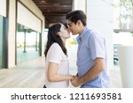 side view of cute couple in... | Shutterstock . vector #1211693581