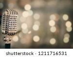 close up of retro microphone... | Shutterstock . vector #1211716531