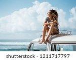 beautiful woman travel by car... | Shutterstock . vector #1211717797